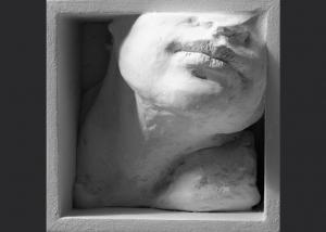 sin título. ensamblaje madera y yeso. 2002. 12x12x7cm